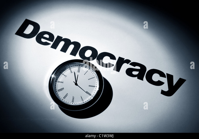 Clock and word of Democracy for background - Stock Image