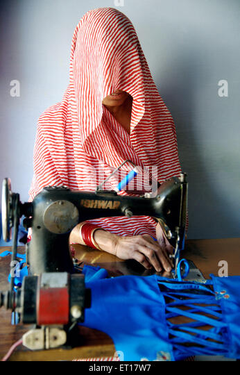 Woman Stitching Cloths India Asia MR#784A - Stock Image