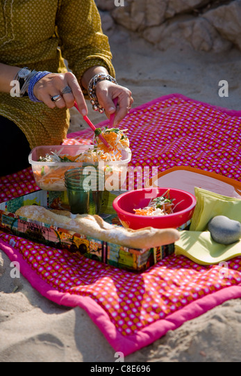 Having parsnip,carrot and lime salad on the beach - Stock Image