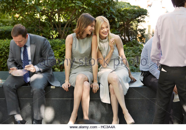 Young businesswomen at business park together. - Stock Image