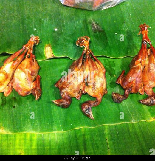 These are dead fried birds sold at Singburi night market,Thailand. - Stock Image