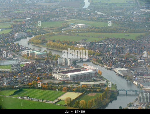 Looking along the River Trent at Nottingham, East Midlands, UK, Notts Forest Football club dominant with Trent Bridge - Stock Image