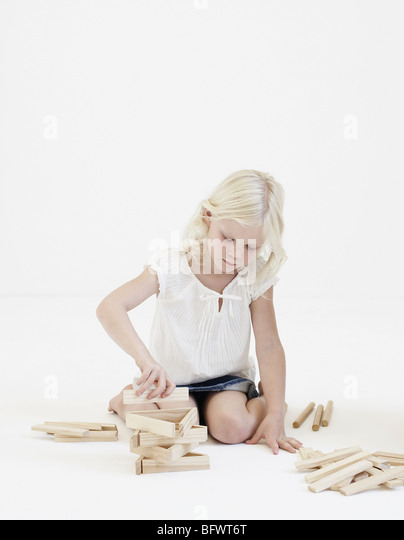 Young girl playing with building blocks - Stock Image