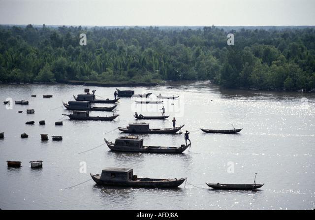 Vietnam Saigon Ho Chi Minh City Saigon River fishing boats floating homes - Stock Image