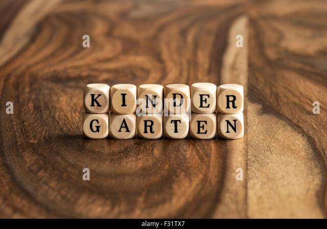 KINDERGARTEN word background on wood blocks - Stock Image
