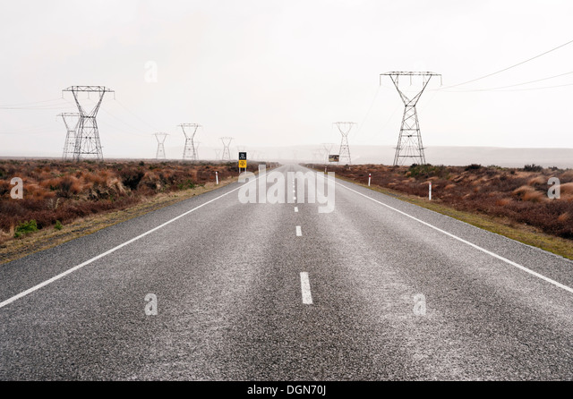 Electricity power lines along Highway 1 Desert Road, in the volcanic region near Lake Taupo, New Zealand - Stock Image