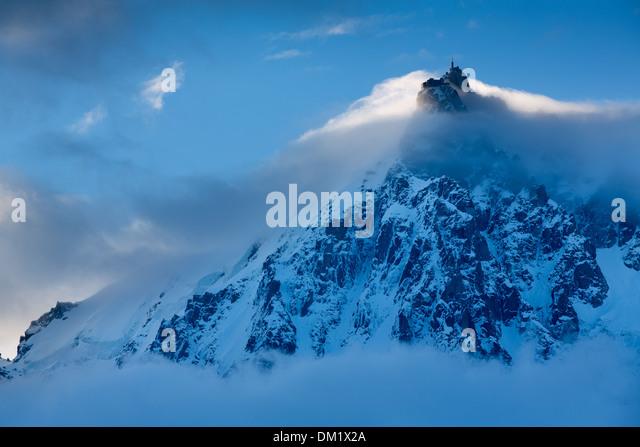 the Aiguille du Midi  appearing through the clouds, Mont Blanc, les Alps, Haute-Savoie, France - Stock Image