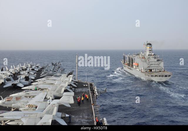 Aircraft carrier USS Dwight D. Eisenhower (CVN 69) and Military Sealift Command fleet replenishment oiler USNS Kanawha - Stock Image