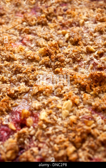 Close up of fruit pie with crumble crust - Stock Image