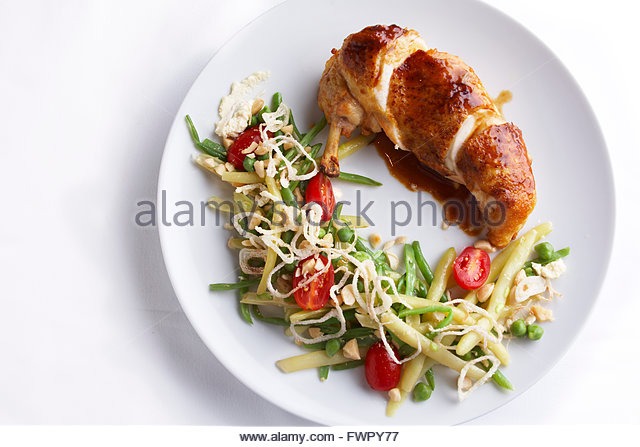 Roasted chicken with new spring vegetables, and reduce wine sauce - Stock Image