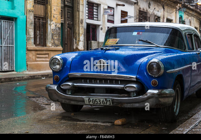 I saw this lovely dark blue classical car on the road side in Centro Havana & found a picture simply too hard - Stock Image