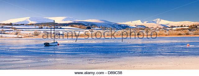 Llangorse Lake Brecon Beacons Powys Wales in winter with Pen y Fan & Corn Du mountains - Stock Image