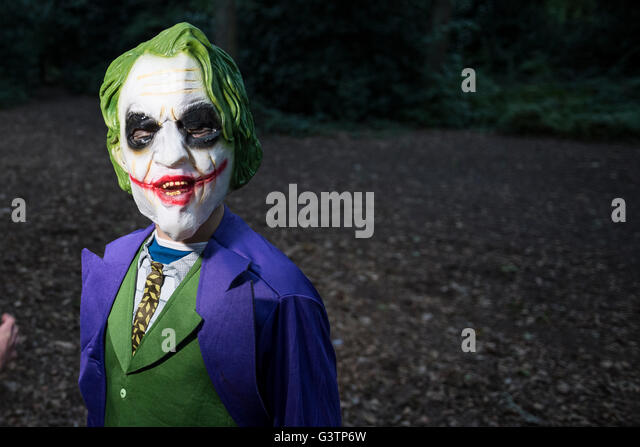 A boy dressed as The Joker for Halloween Night. - Stock Image