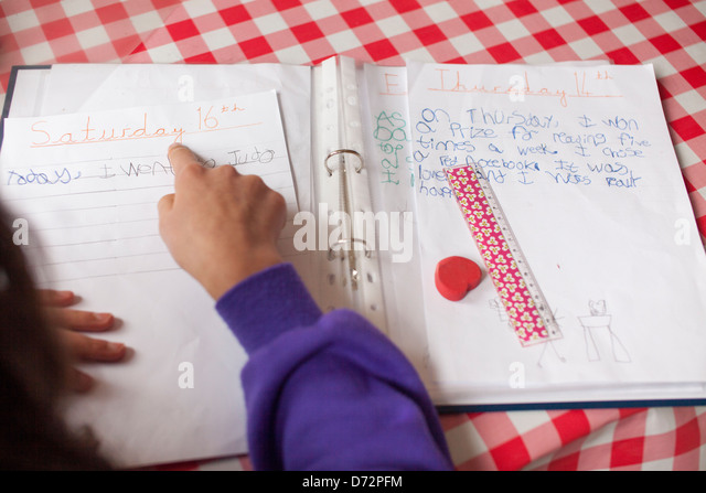 Child reading out his holiday diary - Stock-Bilder