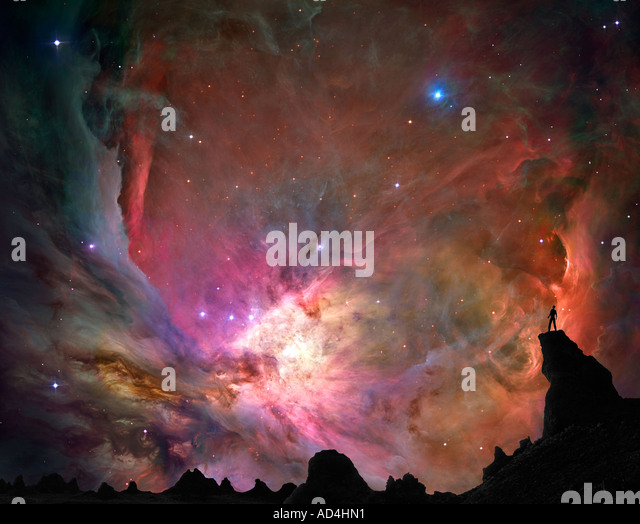 Man on Mountaintop viewing a Nebula - Stock Image