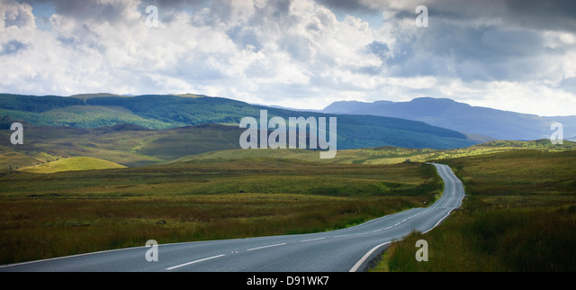 empty road running through rural countryside - Stock Image