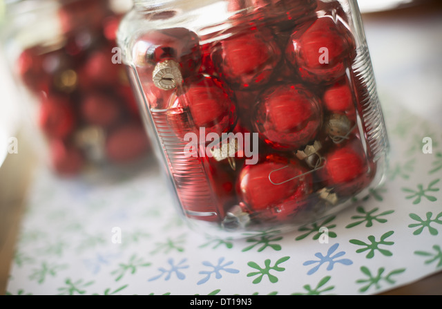 Woodstock New York USA Red glass ball Christmas ornaments in glass jars - Stock Image