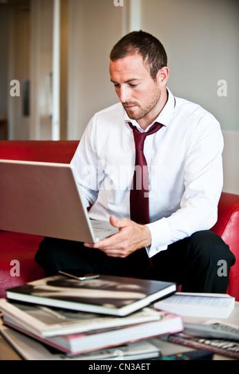 Businessman using laptop - Stock-Bilder