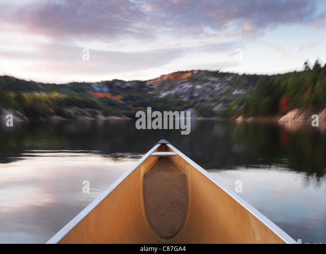 Canoeing at lake George in fall. Killarney Provincial Park, Ontario, Canada. - Stock Image