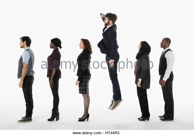 Businessman in queue jumping and peering over colleagues against white background - Stock-Bilder