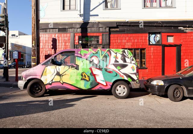 Graffiti painted minivan - USA - Stock Image