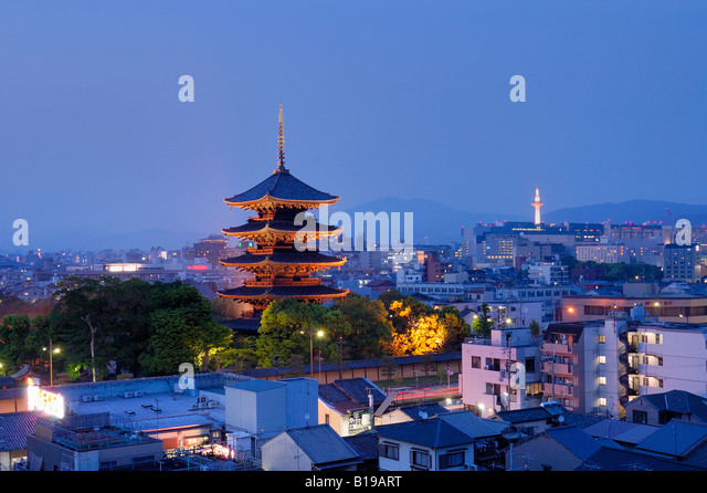 city skyline with Toji temple glowing in the evening Kyoto Japan - Stock Image