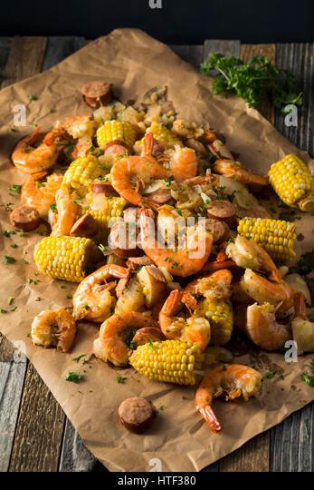 Homemade Traditional Cajun Shrimp Boil with Sausage Potato and Corn - Stock Image