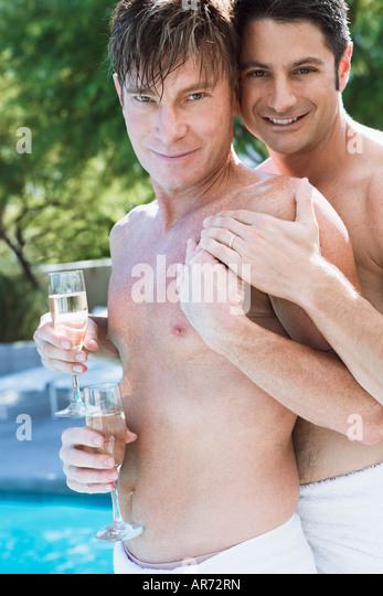 Gay couple showing off their wedding rings - Stock-Bilder