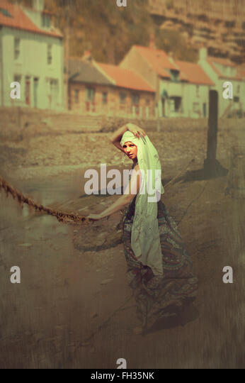 young woman in a village with angry expressions - Stock Image