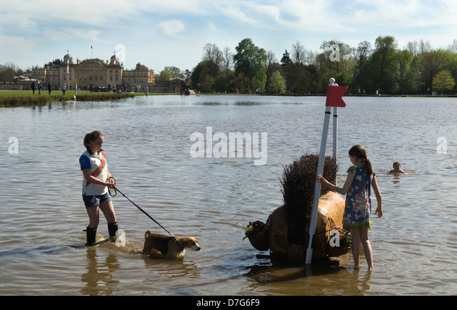 Badminton Horse Trials Gloucestershire UK. Children play in The Lake at the end of the horse trials. HOMER SYKES - Stock Image