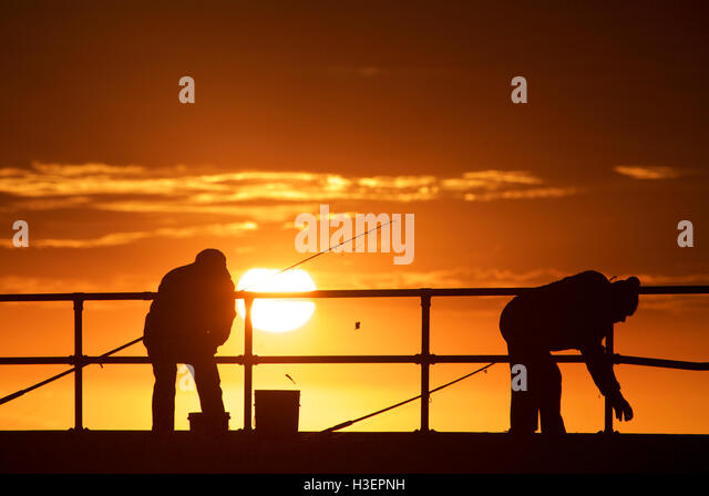 Fishing men at Mordialloc Beach, Port Phillip Bay, Melbourne, Australia - Stock Image