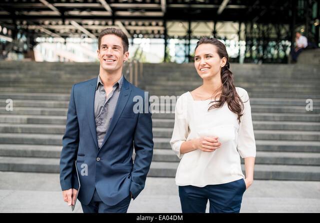 businesswoman and man chatting whilst walking, London, UK - Stock Image