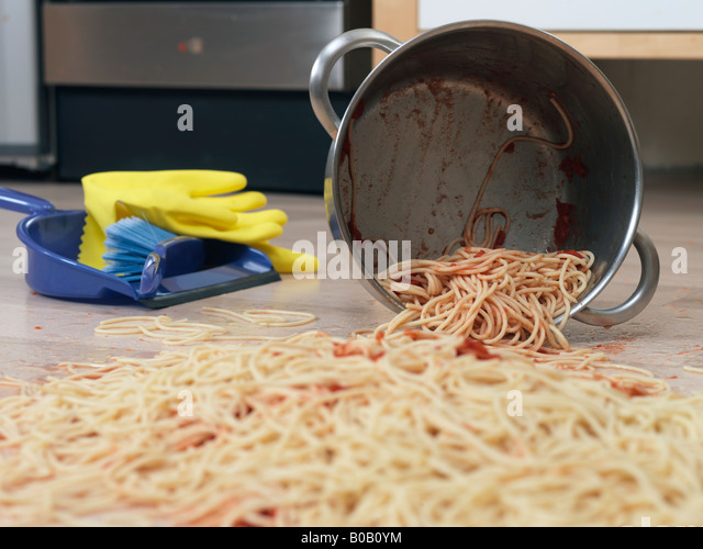 pan of food dropped on kitchen floor - Stock Image