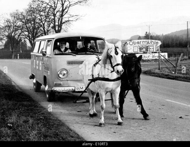 Alternate ways of transport - two horses pulling a Volkswagen - Stock Image