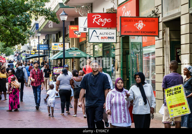 South Africa African Cape Town City Centre center Castle Street pedestrian man woman Muslim hijab businesses - Stock Image