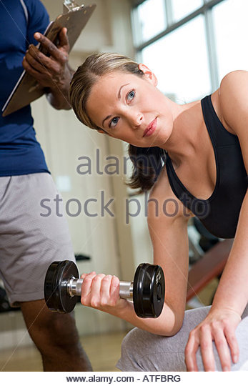 A woman weightlifting - Stock Image