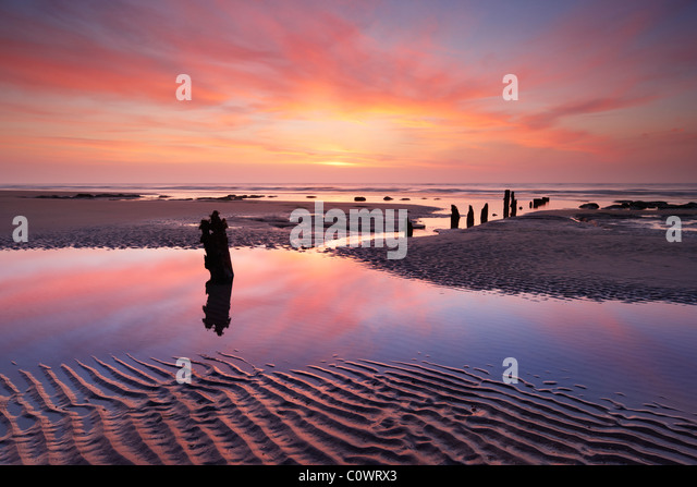 Old wooden sea defences at Winchelsea beach, East Sussex. - Stock Image
