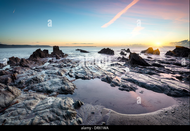 Rock pools on the beach at Looe in Cornwall - Stock Image