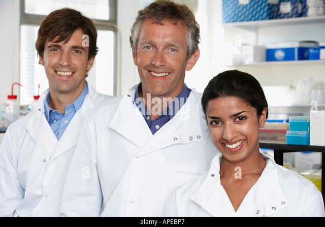 Smiling Lab Workers - Stock Image