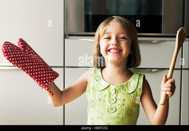 Kitchen Little Girl Casual Child Hobby Leisure Concept - Stock Image
