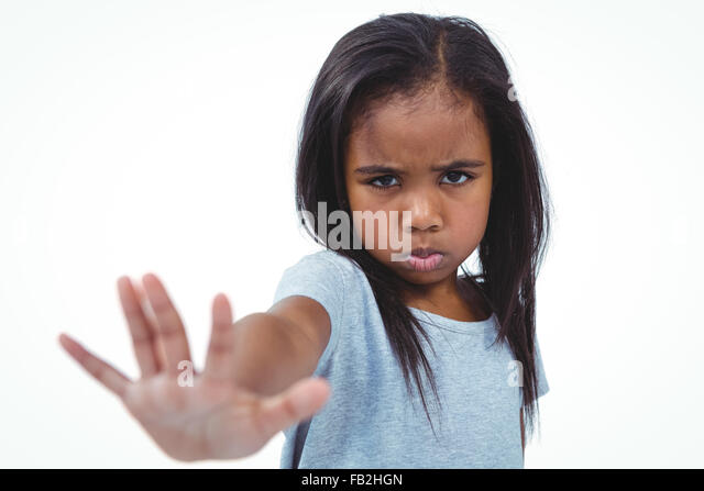 Girl making grimace holding hand to camera - Stock Image