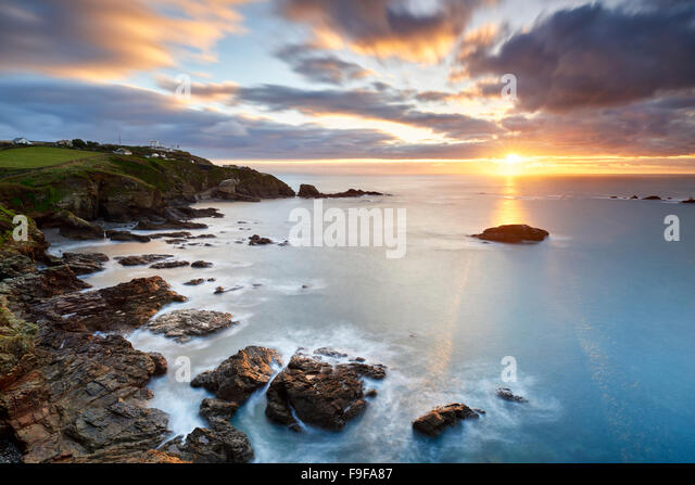 A winter sunrise over Polpeor Cove, The Lizard Cornwall - Stock Image