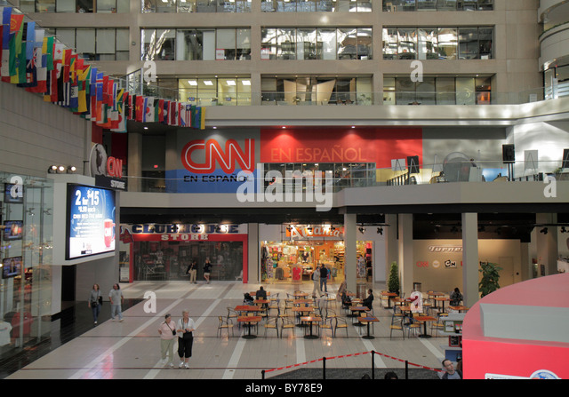 Atlanta Georgia CNN Center atrium store shopping flags CNN en Espanol Spanish language offices - Stock Image