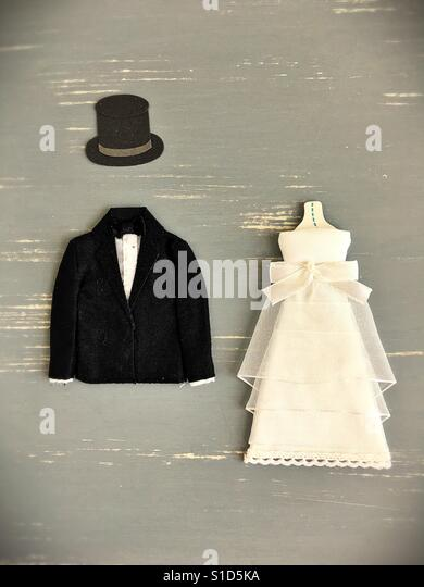 A mini anonymous bride and groom. - Stock Image