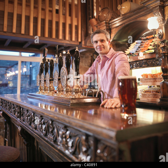 Landlord in English pub - Stock Image