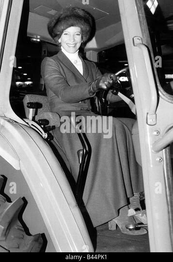 Princess Michael of Kent sits on tractor at Smithfield Show December 1984 - Stock Image