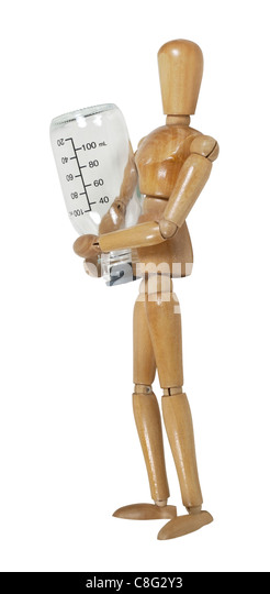 Model carrying a medical glass bottle with fluid measurements written on the sides - path included - Stock Image