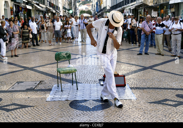 Street Performer on Rua Augusta Street, Lisbon, Portugal - Stock Image