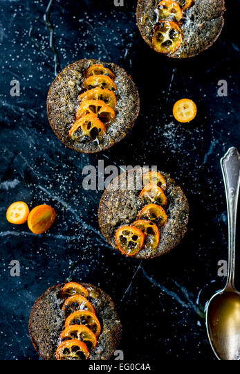 Kumquat and black sesame cakes - Stock Image