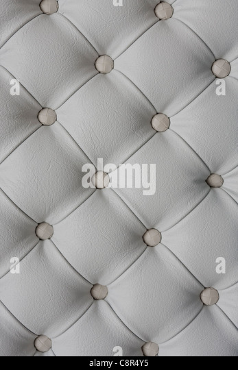 White leather upholstery background - Stock Image